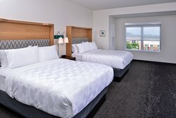 Spread out in our spacious double queen guest room.