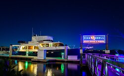 Pink Shell's full-service marina is lit up at night.