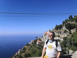 A landscape view of the Amalfitan Coast and myself during a field trip with a Cartotrekking guide.
