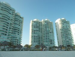 The ocean-front high-rises on Playa Chacmool (at just a few-minute walk from this place by crossing Blvd. Kukulcan right in front)