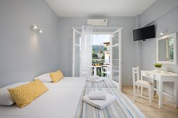 All rooms at Bella studios in Benitses beach Corfu have been renovated recently and feature new, charming designs that are characterised by calm colors and simple decorations. Rooms are comfortably furnished and well-equipped with basic amenities. Rooms include Air conditioning, TV, mini fridge, Wi-Fi, safe box, Tea/coffee making and en suite bathroom with shower and balcony. Also offer a kitchenette