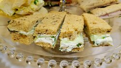 Minted cream cheese and cucumber finger sandwiches.