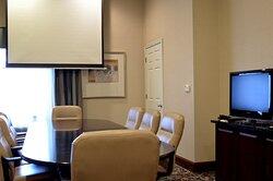 The boardroom features convenient AV equipment.