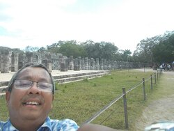 """In front of the Temple of A Thousand Warriors (with some of the pillars """"likely numbering a thousand"""" seen behind me)"""