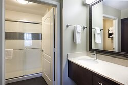 Guestroom Bathroom: Shower, well-lit vanity and privacy door