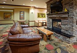 Kick off your cowboy boots and watch TV by the fireplace