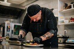 Chef Janos Falvai preparing dishes