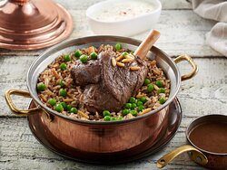 """"""" Ouzi short ribs """" Rice and minced meat cooked with nuts and topped with a short rib."""