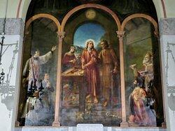 Dipinto con Gesù all'opera