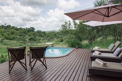 Relax on our pool deck and observe one of our two waterholes, situated just five steps away.