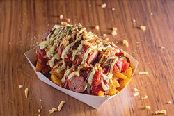Worscht on Fries. German Sausage on top of loaded fries.