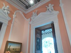 """Small sculptures above a doorway (in one of about 5 or 6 rooms arranged mostly """"one after another"""")"""