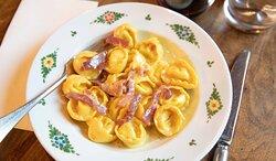 Signature Cappelletti pasta: truffled ricotta ravioli, prosciutto