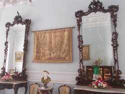 """Two """"grand mirrors"""" & a tapestry in the middle (in one of """"about 10 rooms"""" on the main level)"""
