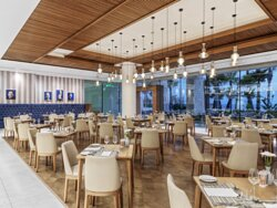Ezaria - Enjoy casual dining and a smorgasbord of breakfast, lunch and dinner dishes with an international flair and creative twist, cooked before your eyes in the open kitchen of this casual-chic restaurant inspired by the Greek 'trapezaria' (dining room).