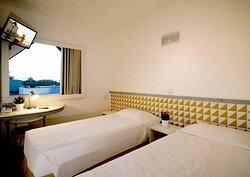 Apartamento com duas camas solteiro