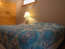 One of the two queen beds in the Suprior Lodge Suites