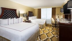 Enjoy this guest room featuring two comfortable queen beds