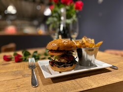 OakVilla Veggie Burger - Grilled mushroom, halloumi with a pepper chutney, watercress & sliced gherkin on a toasted brioche bun, served with a side of hand cut chips.  Also available as Order & Collect