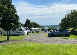 Caravans, motorhomes, campervans paddock with 5 electric hook-ups