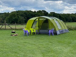 Pre-pitched tents, hassle free camping - including table and chairs