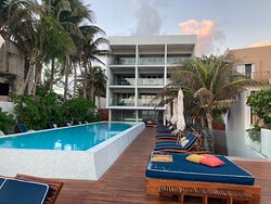 standing at the end of the pool deck, looking back at hotel and the 12 ocean view rooms