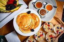 Fresh pancakes, fruit granola