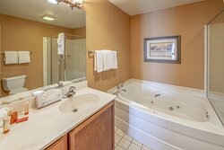Spacious bathroom with large soaking tub in guest villa
