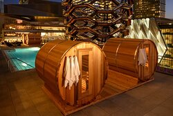 Outdoor Pool Deck with Barrel Saunas