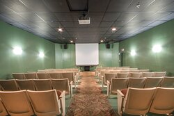 Take a seat and watch movies at our theater throughout the day