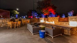 Outdoor Patio with Fireplace at Night