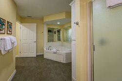 Grand bathroom with bathtub and separate shower