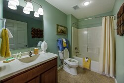 Bathroom with shower/tub combo in a 2- and 3-bedroom villa grand