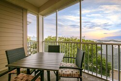 Furnished balcony in a Signature Collection suite to enjoy