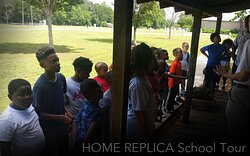 Youth enjoying a tour of the Sharecropper Home.
