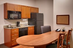 One Bedroom Suites Kitchen and Dining Table