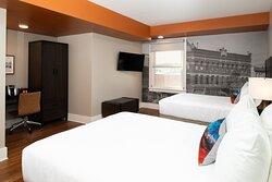 Hotel Indigo Spokane. Deluxe room with two queen beds.