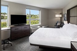 Unwind in our cozy beds in our spacious guestrooms.
