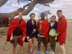 A group of travellers with our director and guise in Seregenti Tanzania