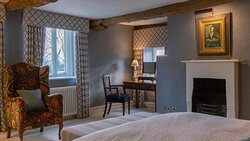 Badminton suite has a double aspect with views over the countryside and rose gardens.