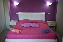 camera letto mini locale nettuno