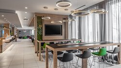 The bright Open Lobby offers useful charging points for devices.