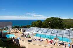 Covered heate pool and aquatic slide