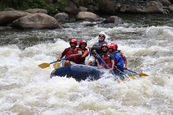 Steve takes family safely through class III rapids.