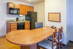 One bedroom Merrillville suites have large dining / work area.