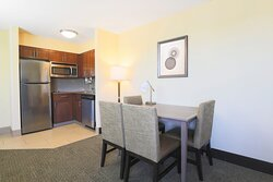 Our Two-Bedroom Suite features a dining area and equipped kitchen.