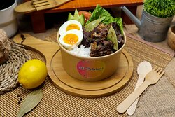 Beef Adobo Rice -  Beef spareribs marinated in soy sauce, vinegar, spices, pan-fried, and stewed until tender served on top of steamed rice with a hard-boiled egg.