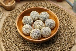 Ube Cheese Buchi - Sticky rice flour filled with ube halaya paste, deep-fried and covered with sesame seeds.