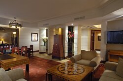 Luxurious Presidential Suite featuring living and dining areas