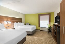 Spacious guestroom new mattresses and linens microwave and fridge